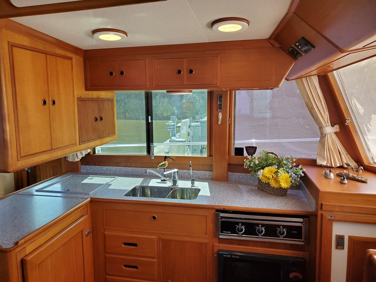 L galley with upper and lower cabinets, 3 burner range, SS sink with cover 2003 GRAND BANKS 42 Classic Trawler 2613061