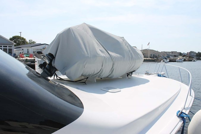 Foredeck with Tender Covered 2002 VIKING 52 Convertible Sport Fisherman 2698644
