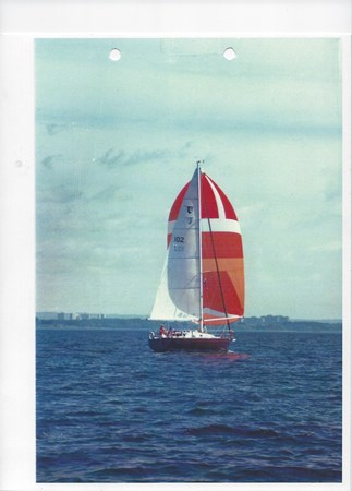 31 Tartan Fire of Spring under spinnaker 1990 TARTAN 31 Cruising/Racing Sailboat 2719689