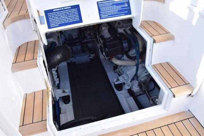 Engine room entrance from cockpit 2015 CUSTOM CAROLINA WARREN O'NEAL 2015 REBUILD Sport Fisherman 2728597