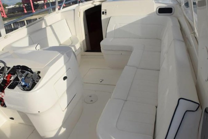 Comfortable helm area seating 2010 INTREPID POWERBOATS INC. Intrepid Sport Yacht with Seakeeper Gyro Walkaround 2761070