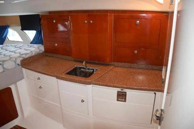 Cherry cabinetry - perfect gloss finish 2010 INTREPID POWERBOATS INC. Intrepid Sport Yacht with Seakeeper Gyro Walkaround 2761083