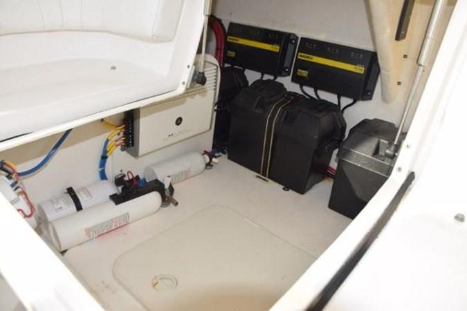 Neat storage areas, JL 500 watt stereo amp 2010 INTREPID POWERBOATS INC. Intrepid Sport Yacht with Seakeeper Gyro Walkaround 2761085