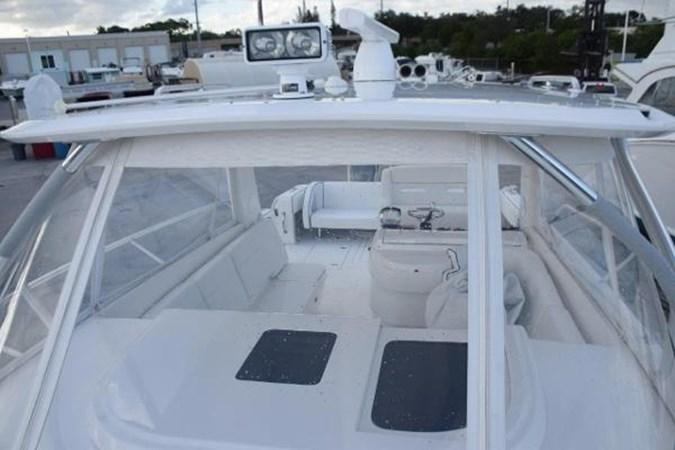 Spotlight on factory hardtop 2010 INTREPID POWERBOATS INC. Intrepid Sport Yacht with Seakeeper Gyro Walkaround 2761086