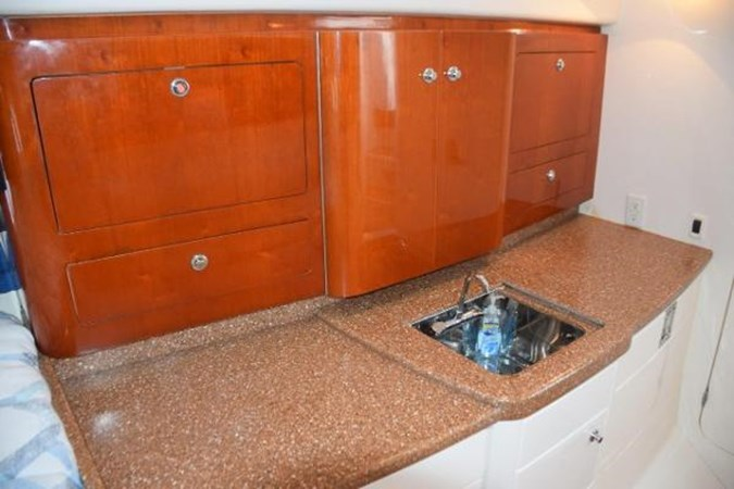 Galley counter and cabinet 2010 INTREPID POWERBOATS INC. Intrepid Sport Yacht with Seakeeper Gyro Walkaround 2761088