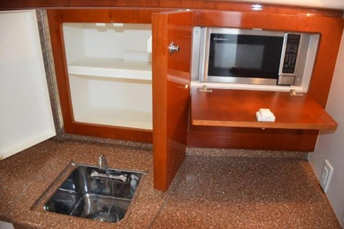 Microwave and cabinets 2010 INTREPID POWERBOATS INC. Intrepid Sport Yacht with Seakeeper Gyro Walkaround 2761090