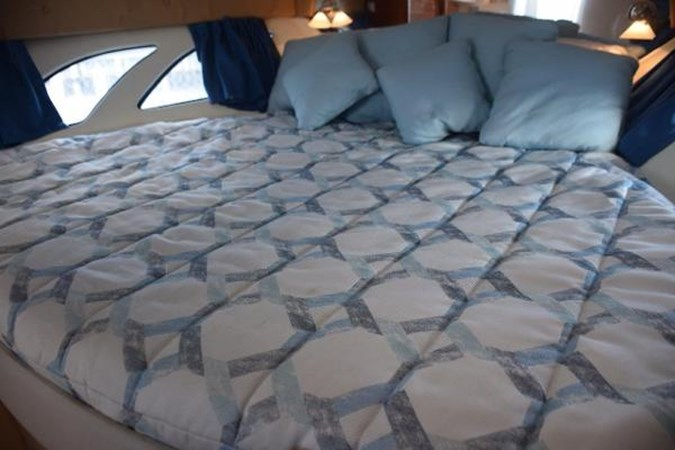 Fresh bedspread and pillows 2010 INTREPID POWERBOATS INC. Intrepid Sport Yacht with Seakeeper Gyro Walkaround 2761096