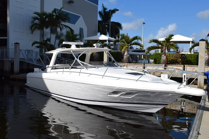 White hull with side windows 2010 INTREPID POWERBOATS INC. Intrepid Sport Yacht with Seakeeper Gyro Walkaround 2761099