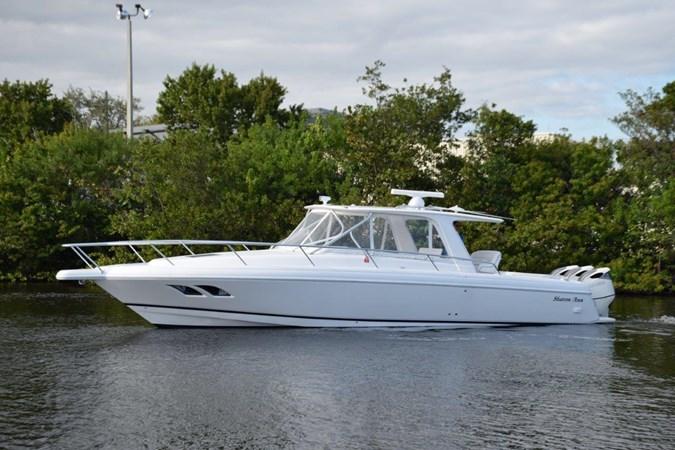 White hull, white motors, Sharp! 2010 INTREPID POWERBOATS INC. Intrepid Sport Yacht with Seakeeper Gyro Walkaround 2773360