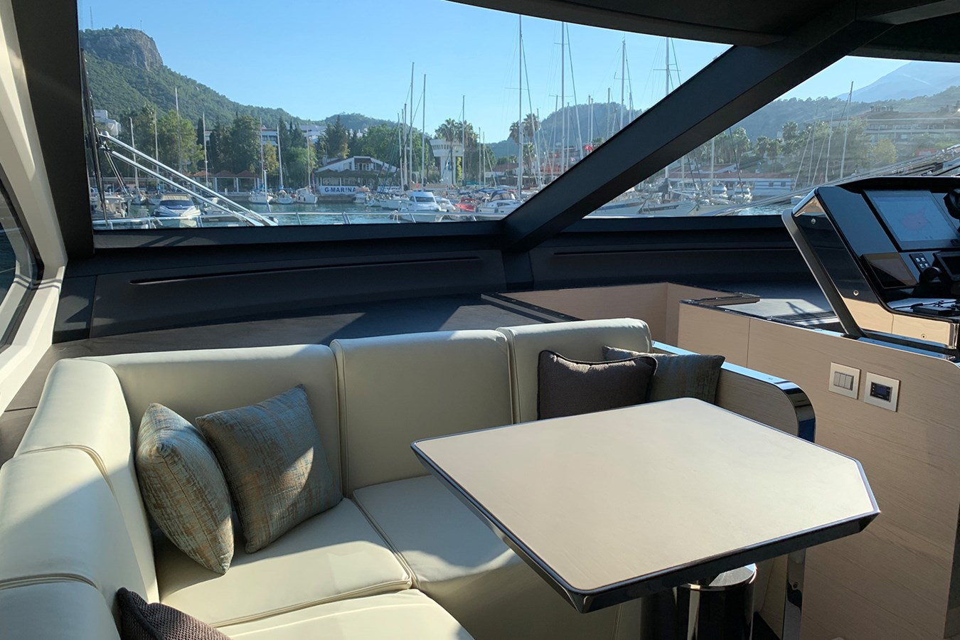Seating area near helm station 2018 AZIMUT 80 Motor Yacht 2746635