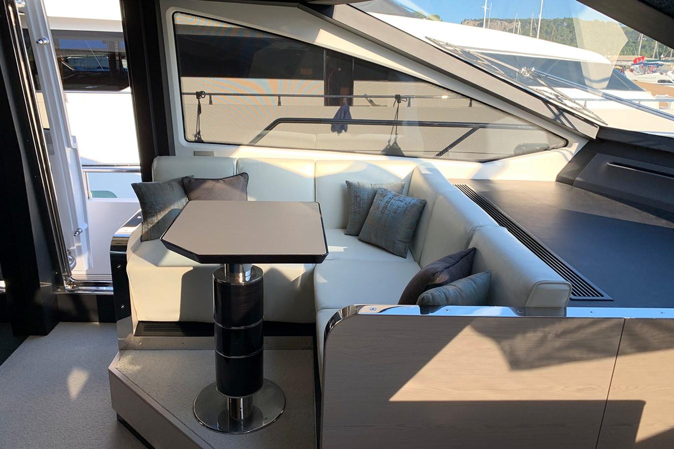 Seating area near helm station 2018 AZIMUT 80 Motor Yacht 2746641