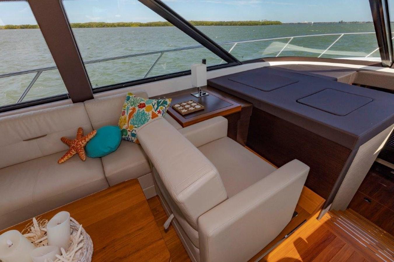 salon port seat fwd facing 2017 TIARA 53 Flybridge Cruiser 2799141