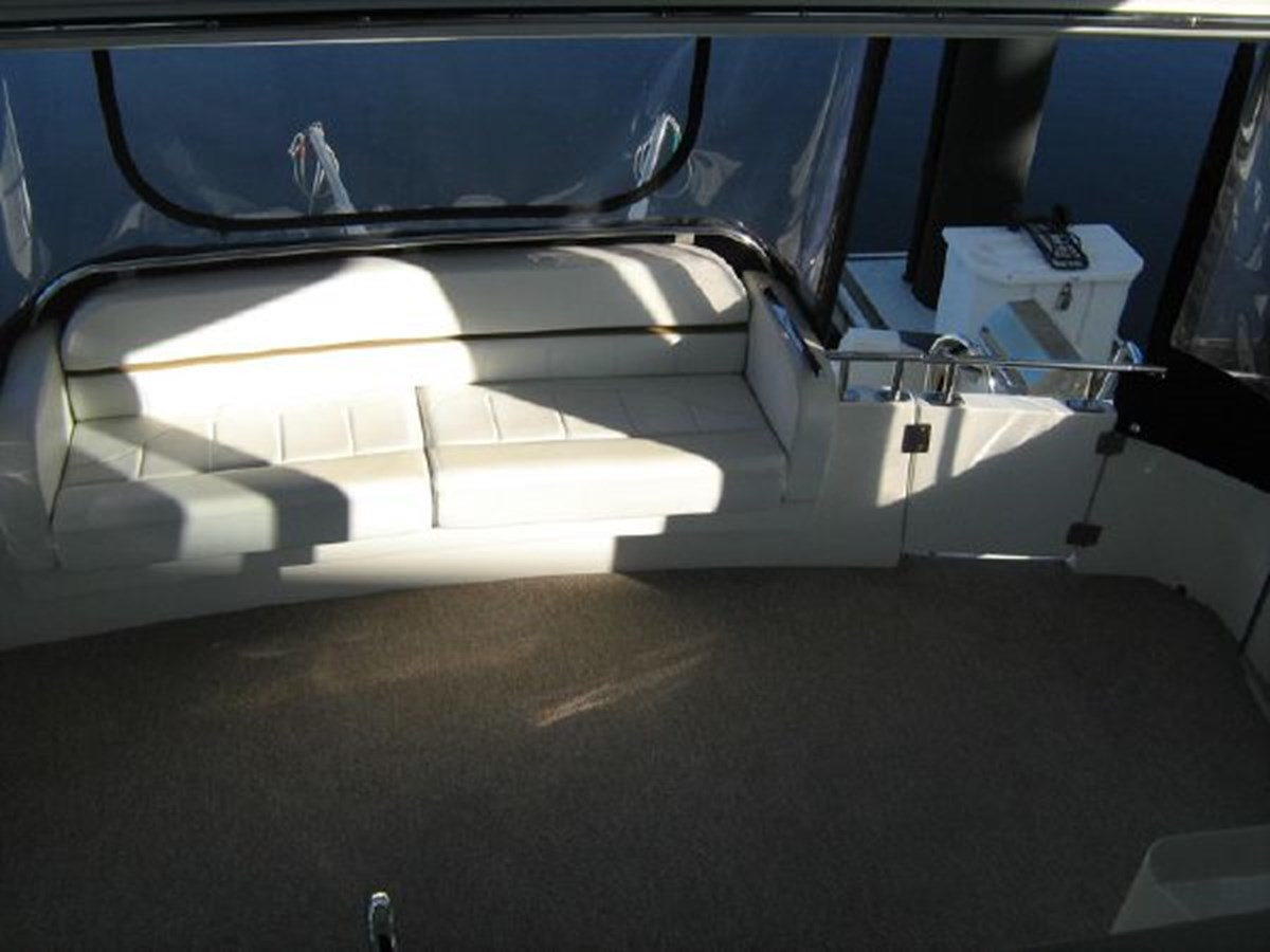 aft deck settee from bridge 2005 CARVER 444 Motor Yacht 2816808