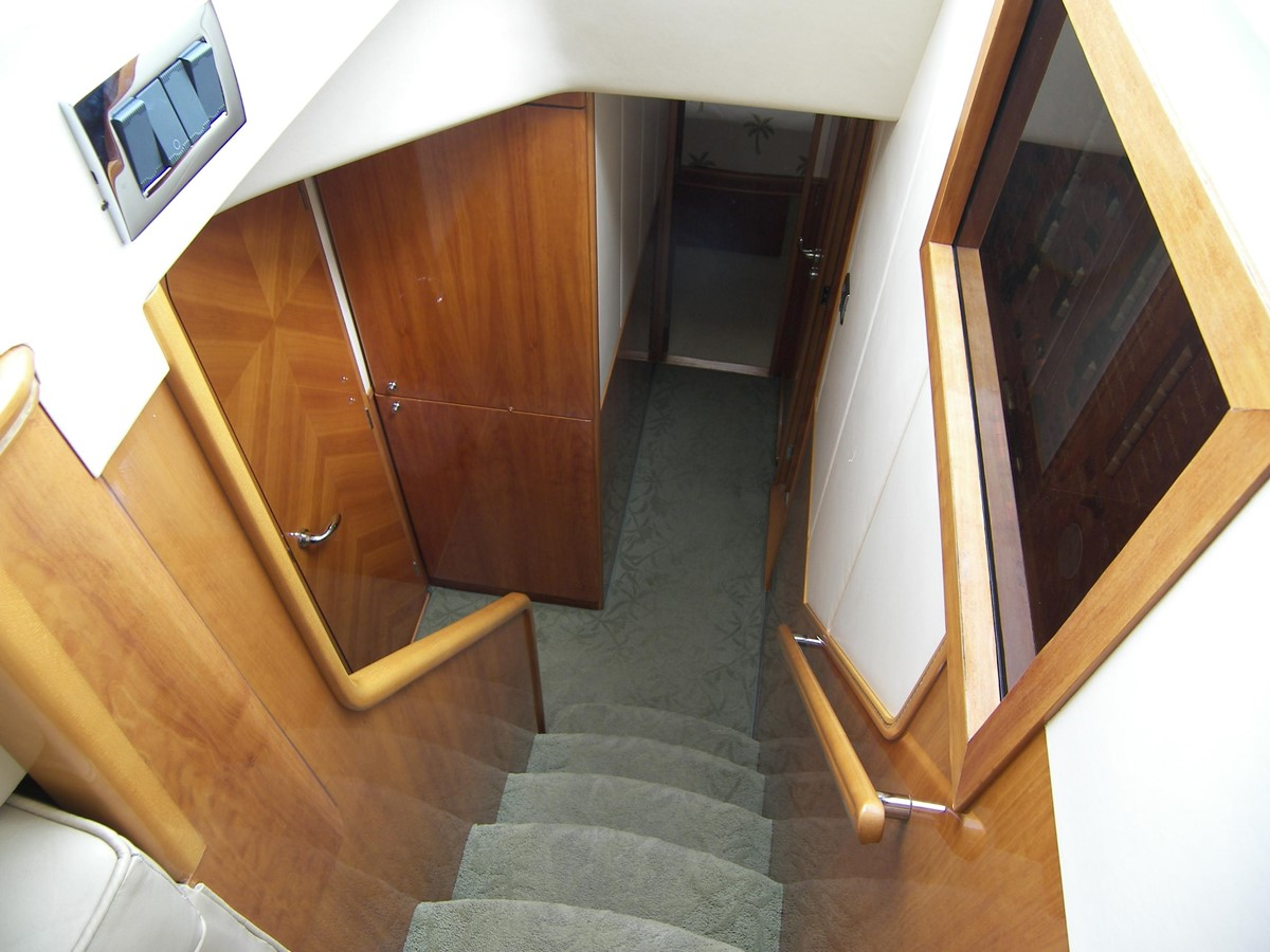 Stairs Down to Forward Staterooms, Port side Over/Under Stateroom 2001 VIKING SPORT CRUISERS 68 Motor Yacht  2862935