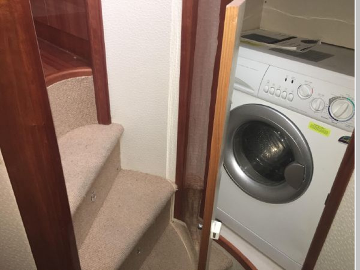 Washer dryer adjacent to day head 2006 AICON YACHTS 56 Motor Yacht 2950920