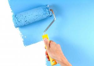 homeowner painting a wall