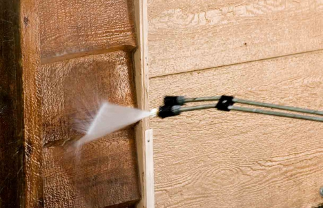 Pressure wash the siding of your house