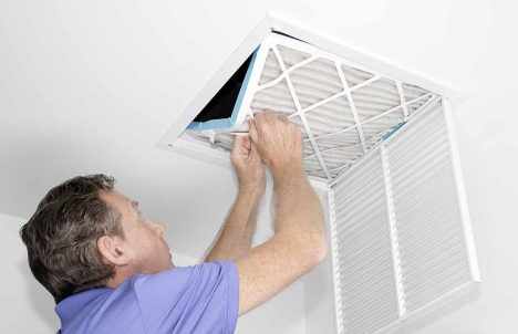 Changing a filter in the ceiling
