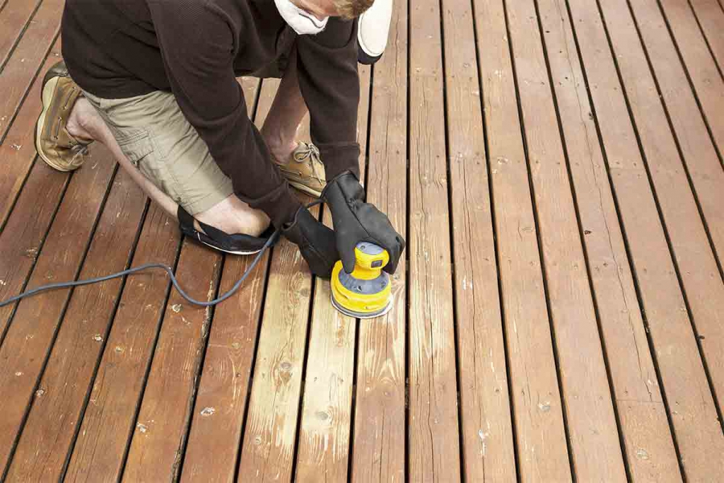 contractor sanding deck boards