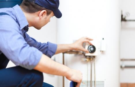 plumber installing hot water heater