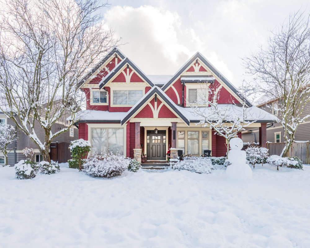 Red Craftsman style house in snow