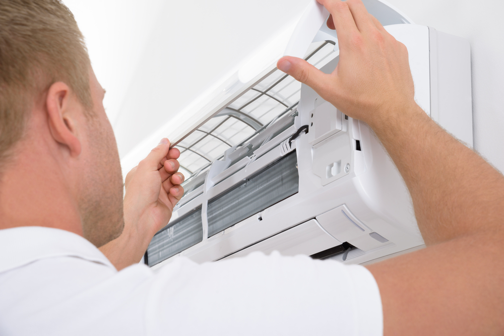 man installing ductless mini split system