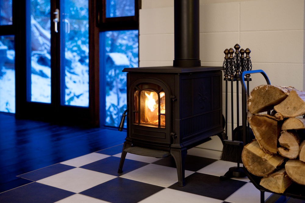 wood burning stove on noncombustible floor pad