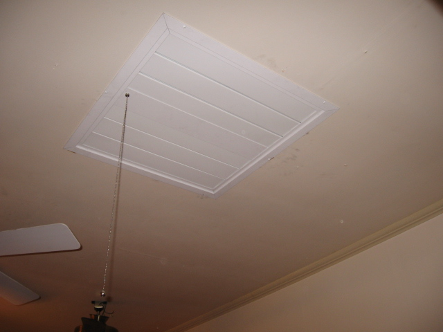 close-up of white fan vent in ceiling