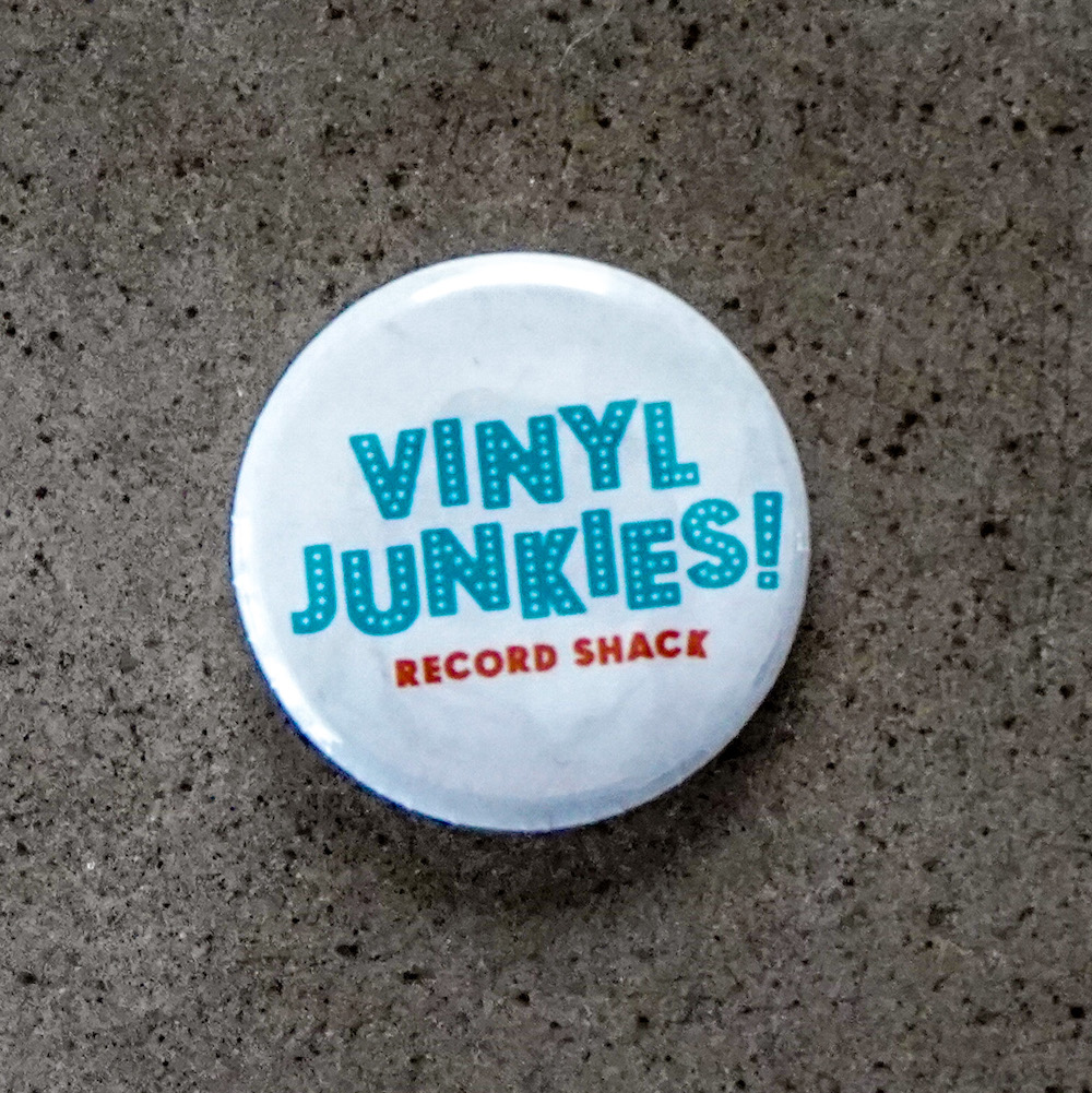 - White pin with Blue Vinyl Junkies logo