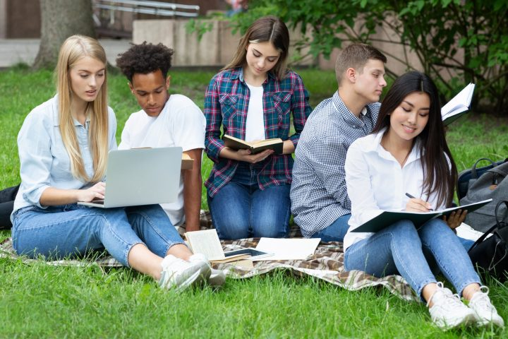 Exam preparation. Students studying in college campus