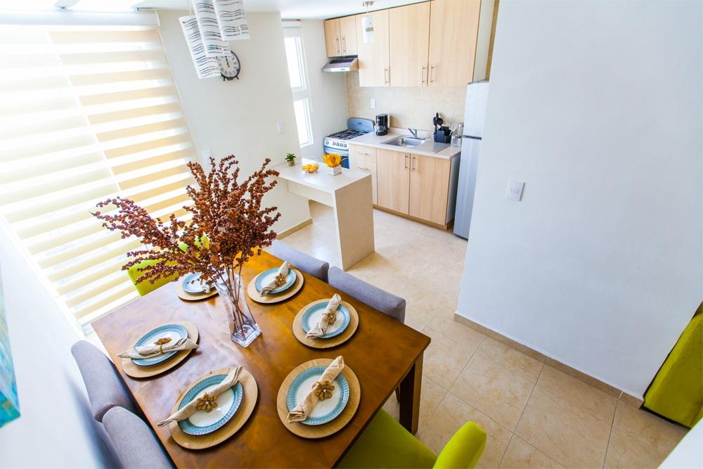Fotografía de comedor y cocina casa modelo Encino plus de Javer Residenza Privadas en Coacalco