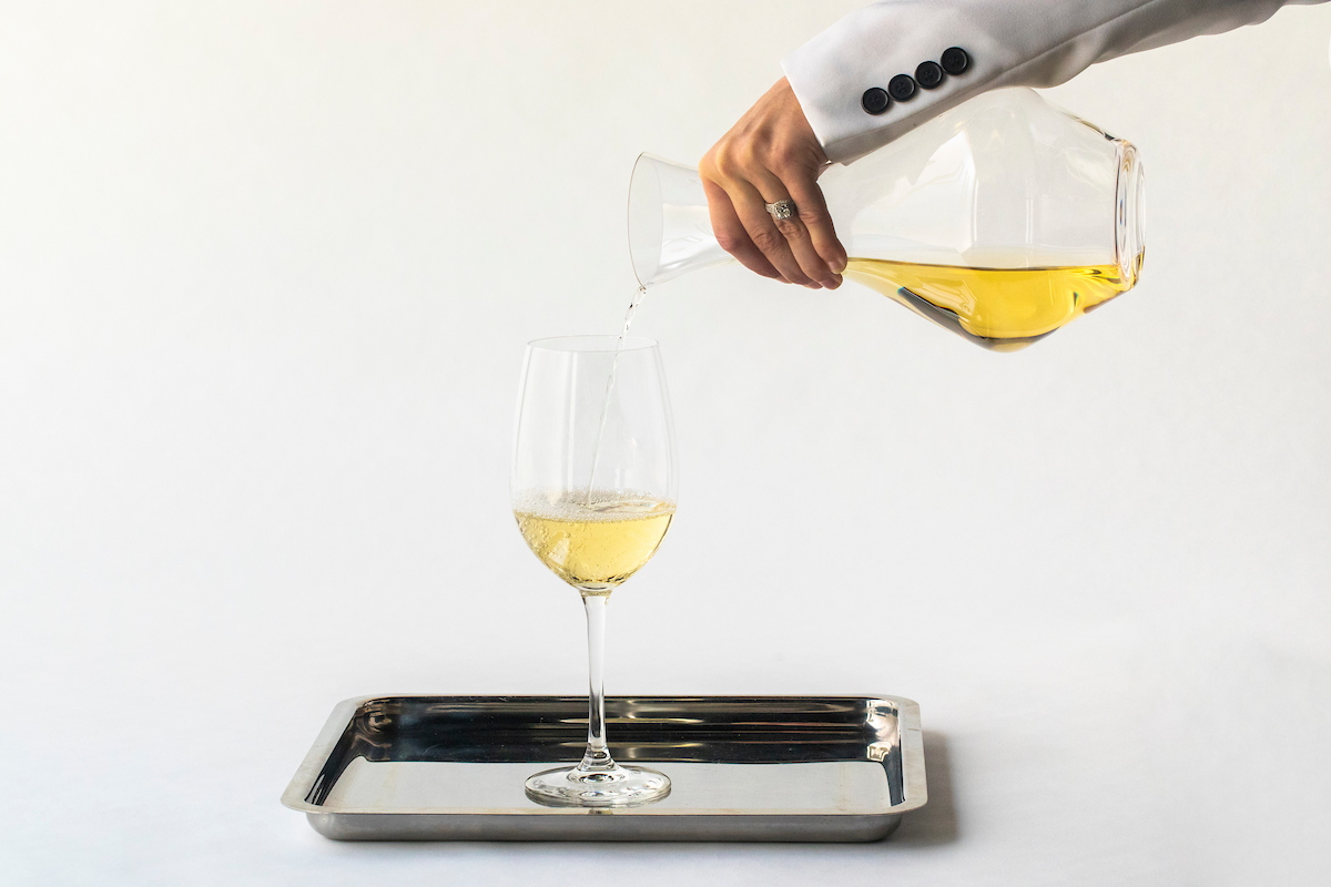RPM server pouring white wine