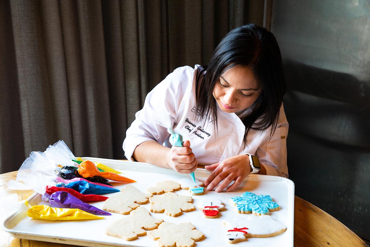 Yasmin decorating cookies