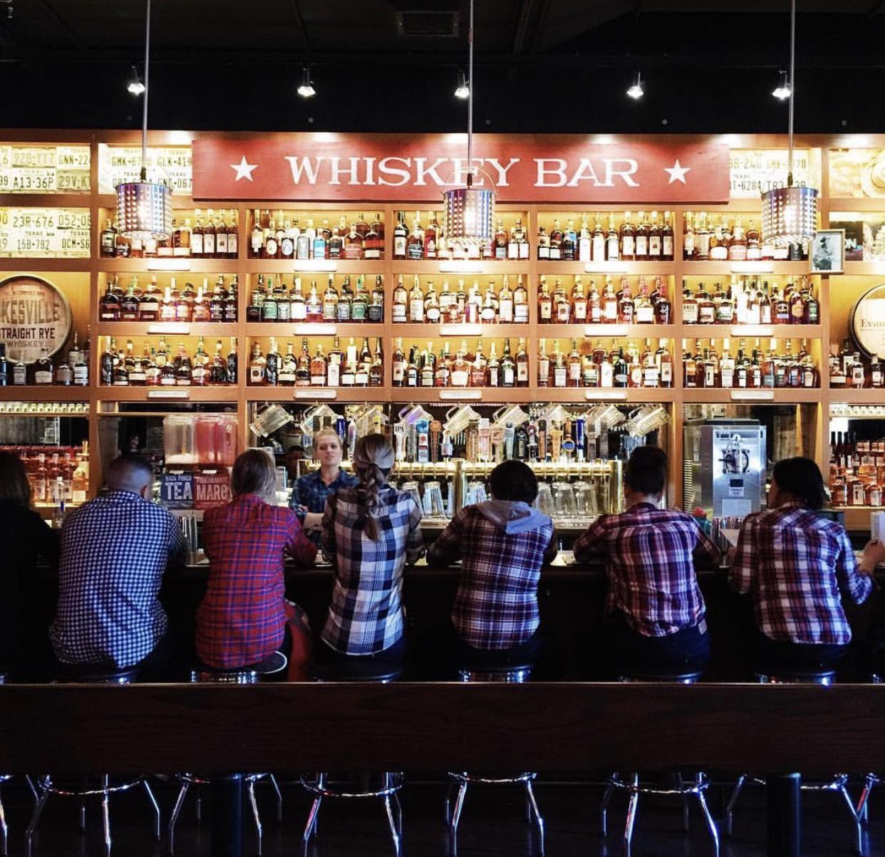 staff at whiskey bar at bub city