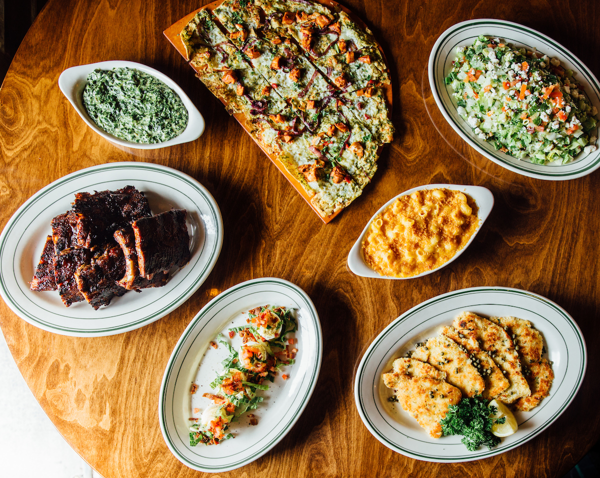 flatbread, mac and cheese, a salad, ribs and creamed spinach