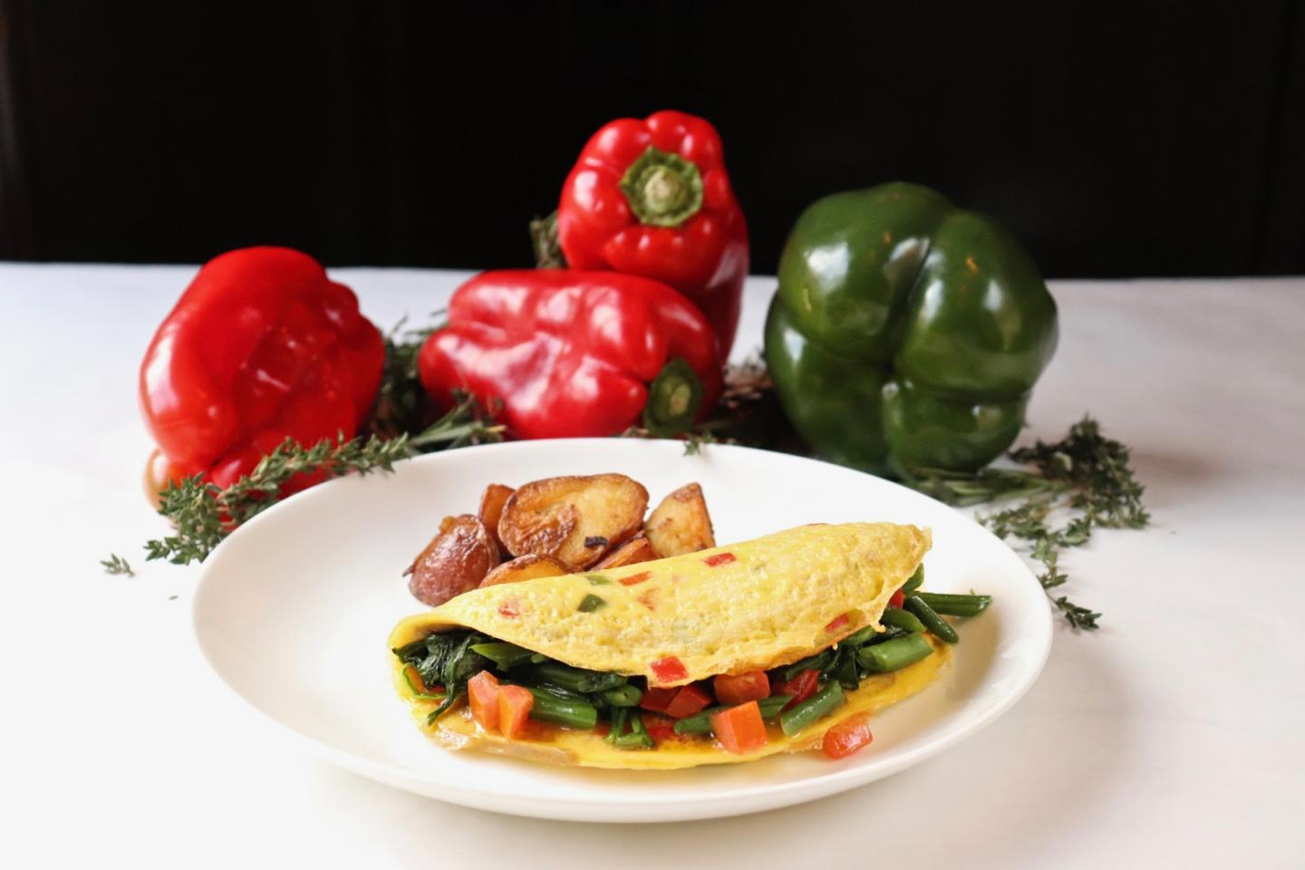 Vegetable omelette plate with spinach, peppers, mushroom, tomato, green beans at Mon Ami Gabi Reston