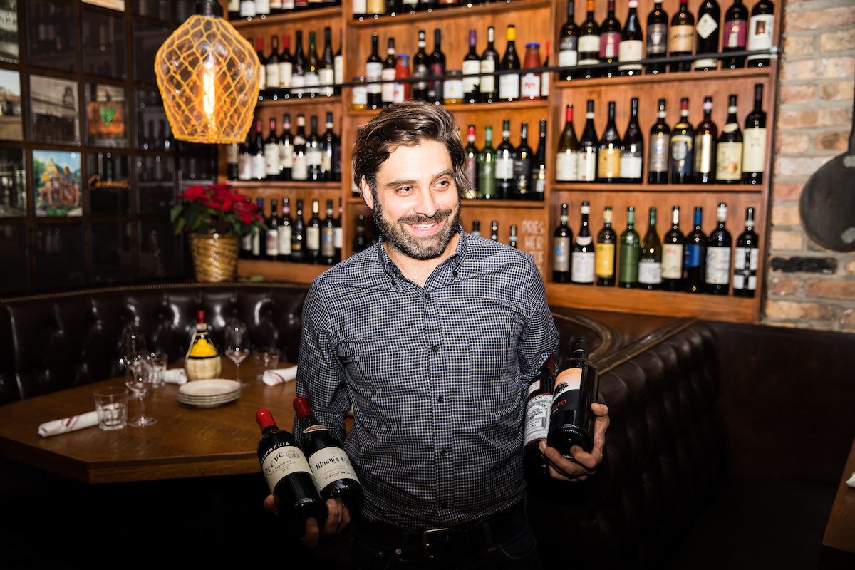 Wine Director Ryan Arnold holding a selection of the La Nascosta Wines