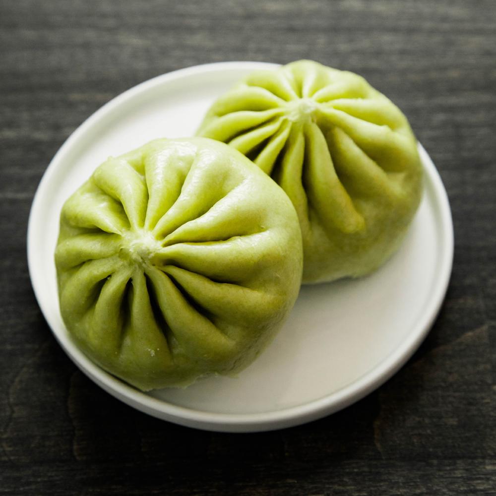 2 green baos on a plate