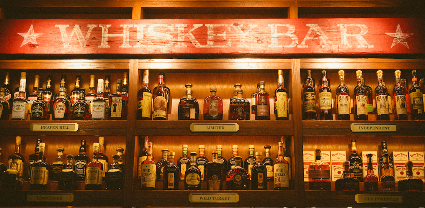 Image of bub city's whiskey bar with over 200 bottles of whiskey