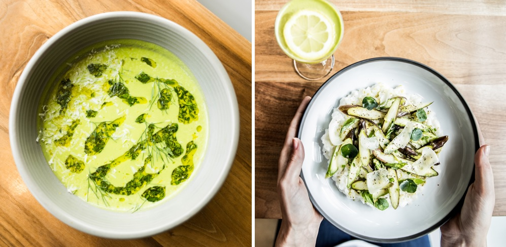 2 side by side images: left is a bowl of pea soup with green oil as a garnish. right is two hands holding a bowl of pea risotto on a wooden table with a cocktail next to it with a lemon wheel garnish, all at Ema