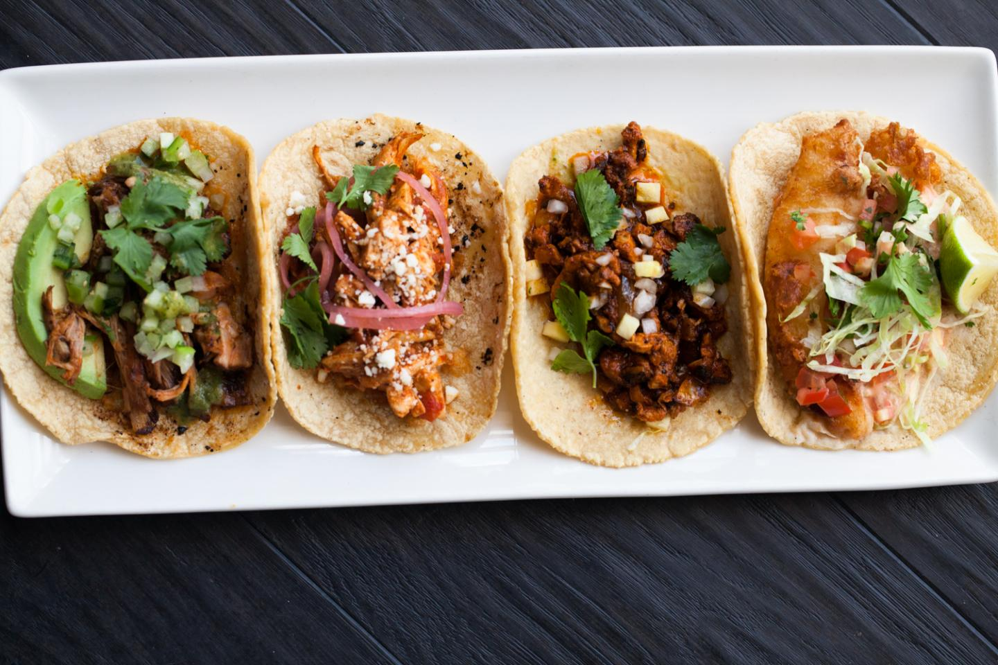 image of four tacos on a plate from Tallboy Taco
