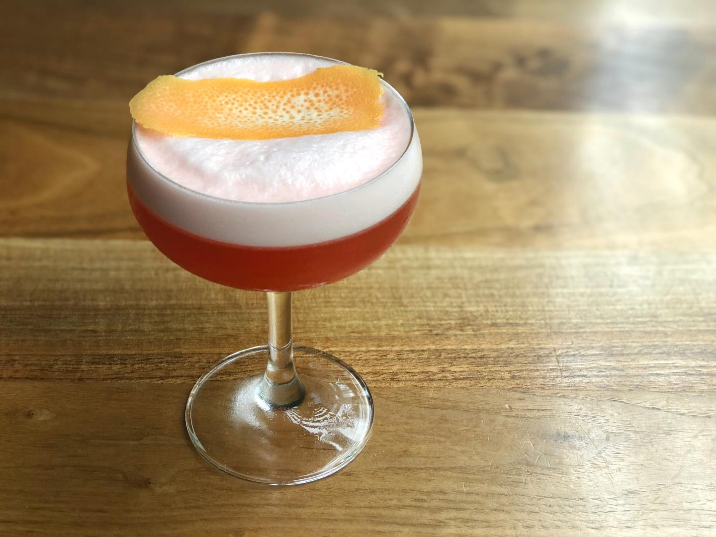 Ema's negroni sour on a wood table