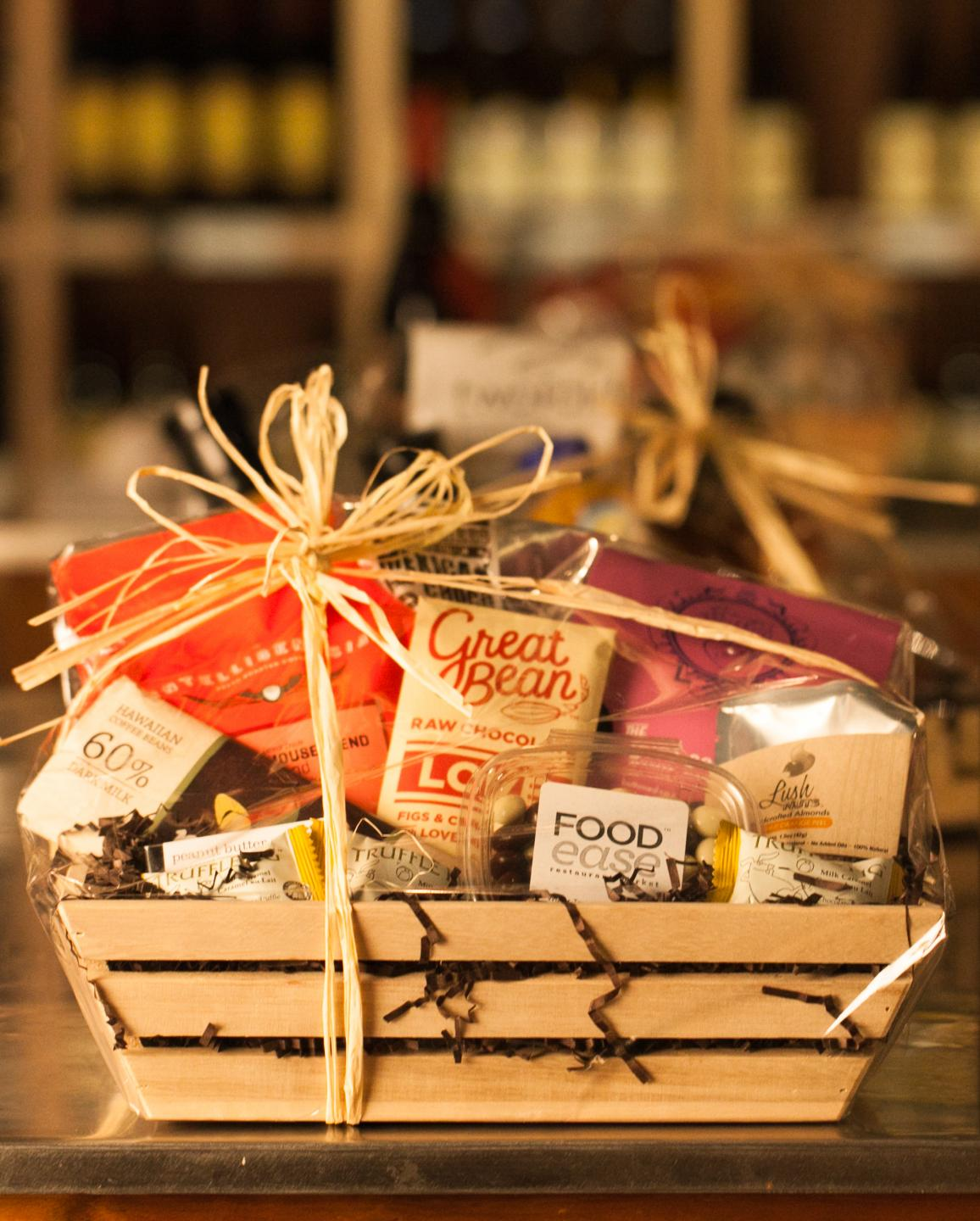 gift basket from foodease with an asortment of goodies, in a wooden basket tied with a piece of hay
