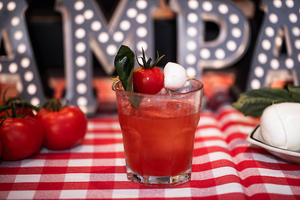 il porcellino's caprese negroni with tomatoes & mozzarella balls on the glass and in background