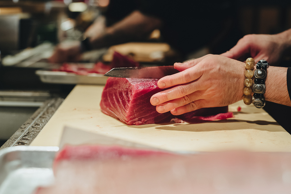 knife cutting through tuna at Sushi-san