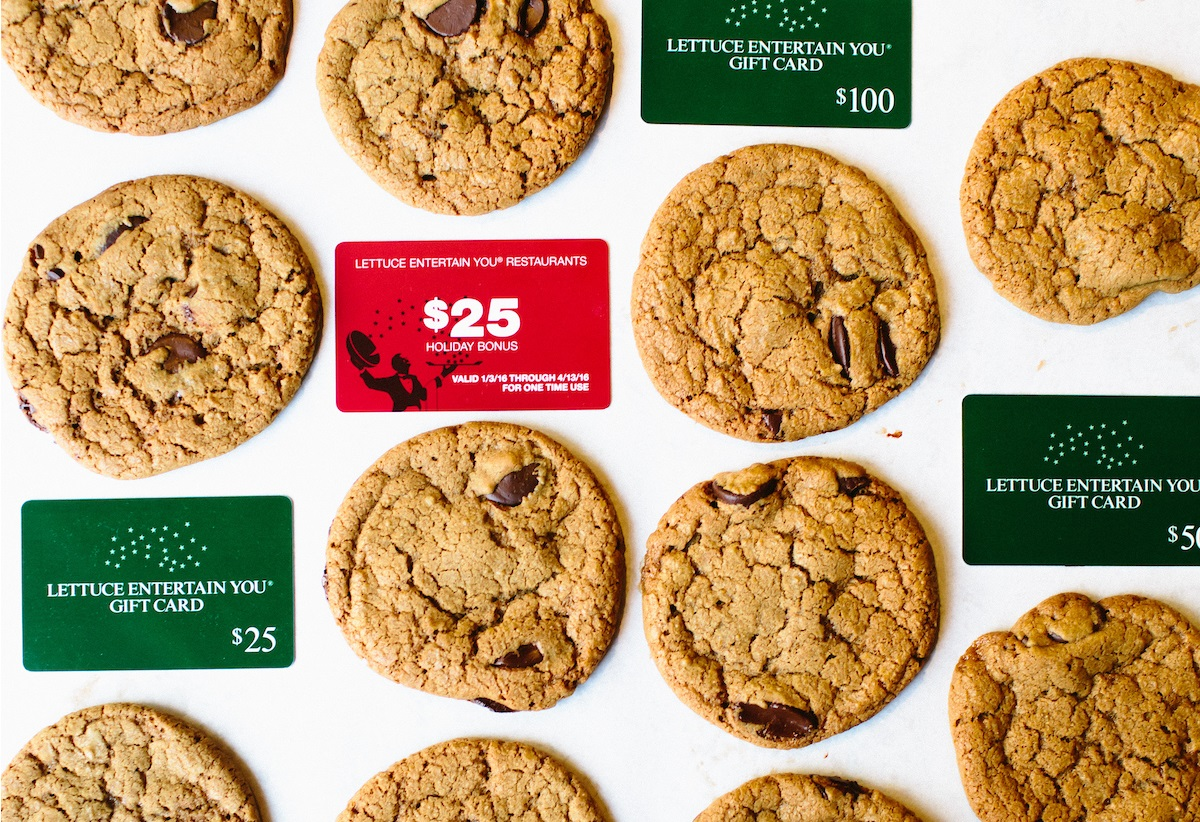 cookies on a table with gift cards scattered throughout