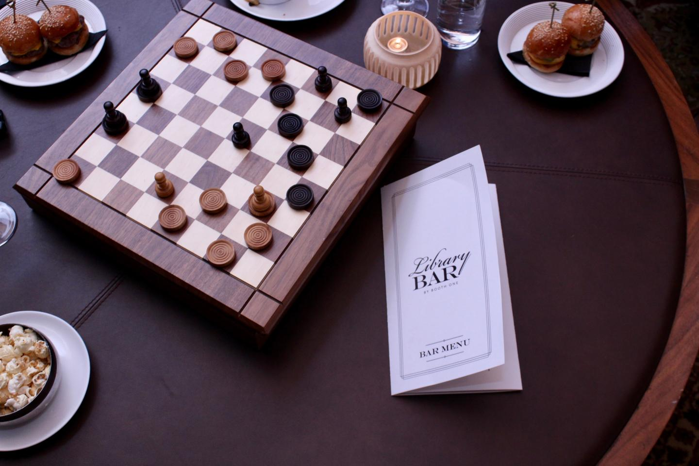 Booth One chess board at Happy Hour