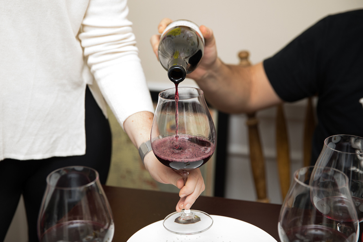 Beaujolais being poured into a burgundy glass
