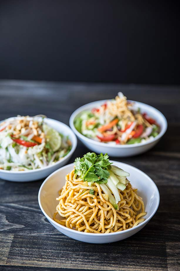Bowl of noodles and two salads from Wow Bao