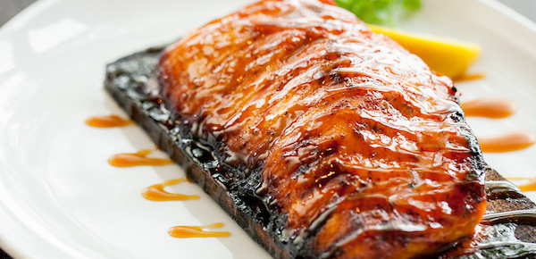 A plate of cedar planked salmon